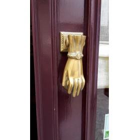 Heurtoir laiton en forme de main à bracelet
